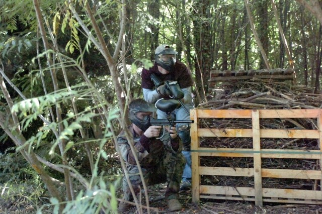 Sky Soldiers from Bravo Company, 1st Battalion, 503rd Infantry Regiment (Airborne) take aim during a game of paintball as part of the Warrior Adventure Quest pilot program Sept. 9 in Padova, Italy.