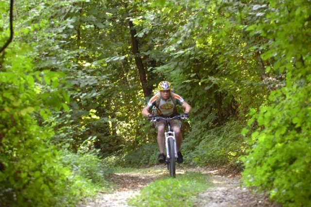Spc. Joshua Grant, Bravo Company, 1st Battalion, 503rd Infantry Regiment (Airborne) enjoys an off-road, down-hill descent during a day of mountain biking as part of the Warrior Adventure Quest pilot program Sept. 10 in Vicenza, Italy.