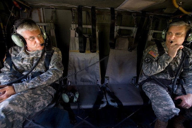 Chief of Staff of the Army Gen. George W. Casey, Jr., speaks with Maj. Gen. Tony Cucolo onboard a UH-60 Blackhawk helicopter leaving from Ft. Stewart, Ga., Sept. 14, 2008.