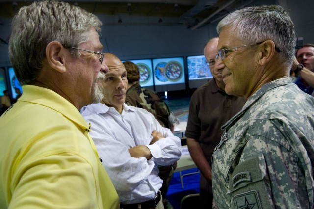 Chief of Staff of the Army Gen. George W. Casey, Jr., speaks to Ed Washington, left, retired FBI special agent, and Scott Well, retired federal coordinating officer at FEMA, during a chemical, biological, radiological, nuclear and high-yield explosive incidents (CBRNE) Consequence Management Response Force CCMRF exercise at Ft. Stewart, Ga., Sept. 14, 2008.  CCMRF is designed to educate key leaders and staff on the response environment and to train them to work together as a joint team.