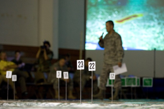 A participant of a chemical, biological, radiological, nuclear and high-yield explosive incidents (CBRNE) Consequence Management Response Force CCMRF exercise briefs his unit's responsibilities in response to the simulated scenario at Ft. Stewart, Ga., Sept. 14, 2008.   CCMRF is designed to educate key leaders and staff on the response environment and to train them to work together as a joint team.