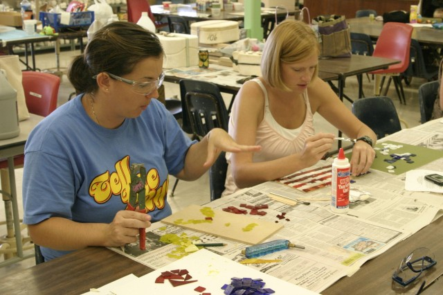 SCHOFIELD BARRACKS, Hawaii - Jessica Acfalle (left) and Carrie Scheib create patriotic-themed mosaic pieces during a class at the Schofield Barracks Arts & Crafts Center. Blue Star Card holders enjoyed the free day of fun and art, each creating one-of-a-kind artwork to take home with them.