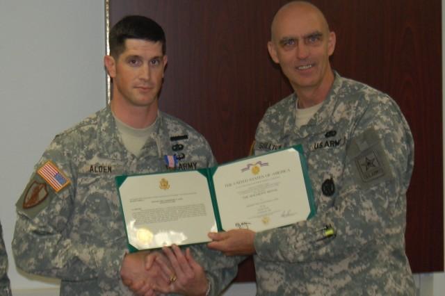 Albany Recruiting Battalion recruiter Sgt. 1st Class Michael Alden, of Kaiserslautern, receives the Soldiers Medal from his battalion commander, Lieut. Col. Ken Sullivan.
