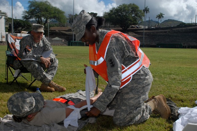 FORT SHAFTER, Hawaii - Private Laqwen Collette, a paralegal from the 130th Engineer Brigade, conducts first aid during the Warrior Task Training portion of the Paralegal Challenge. (photo by Staff Sgt. Crista Yazzie, USARPAC Public Affairs)