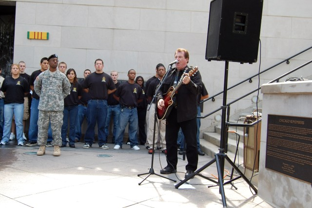 "Joe Cantafio, a Chicago musician and former lead singer of the group Jade 50's, honors the new recruits and veterans by singing songs such as ""American Soldier"" and ""Proud to Be an American"" for the crowd at a Service Recognition Ceremony at the Vietnam Veterans' Memorial Plaza September 11, 2008."