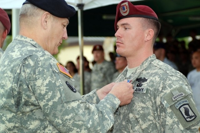 Gen. Cart Ham, commander of U.S. Army Europe, awards Staff Sgt. Erich R. Phillips, mortar platoon sergeant for Chosen Company, 2nd Battalion, 503rd Infantry Regiment (Airborne), the Distinguished Service Cross, Sept. 15, 2008, in Vicenza, Italy, for actions performed in Nuristan Province, Afghanistan Aug. 22, 2007. Phillips, from Eastpoint, Fla., coordinated the last line of defense after Taliban extremists over ran half of his unit's remote base. The DSC is the second highest military decoration that can be awarded a Soldier from the U.S. Army. Phillips is the fifth servicemember to be awarded the DSC for actions during Operation Enduring Freedom.