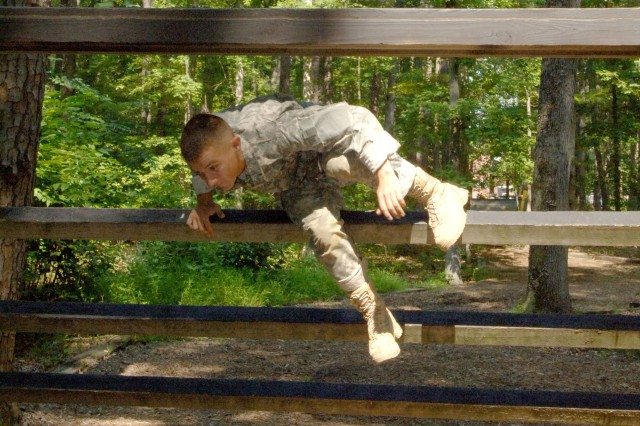 Spc. Daniel Horner negotiates an inverted-climb obstacle during the July 15 Fort Eustis, Va., Confidence Course event that was part of the 2008 U.S. Army Training and Doctrine Command NCO and Soldier of the Year Competition. A total of five Soldiers from across the nation competed for the top TRADOC title. Spc. Horner, the Soldier of the Year winner, represented Fort Benning, Ga., and U.S. Army Accessions Command.