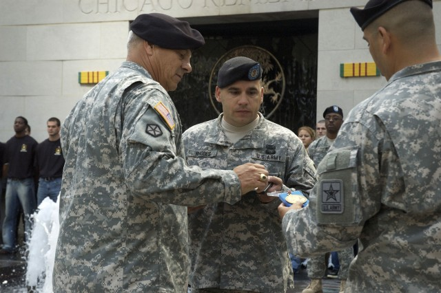 Gen. William S. Wallace, Commanding General U.S. Army Training and Doctrine Command, Fort Monroe, Va., presents Sgt. 1st Class Douglas Rhodes, U.S. Army Chicago Recruiting Battalion, with the prestigious Glen E. Morrell Award during a Service Recognition Ceremony at the Vietnam Veterans' Memorial Plaza in Chicago, Ill., September 11, 2008.  The Glen E. Morrell Award is the highest recruiting award a Soldier can earn.