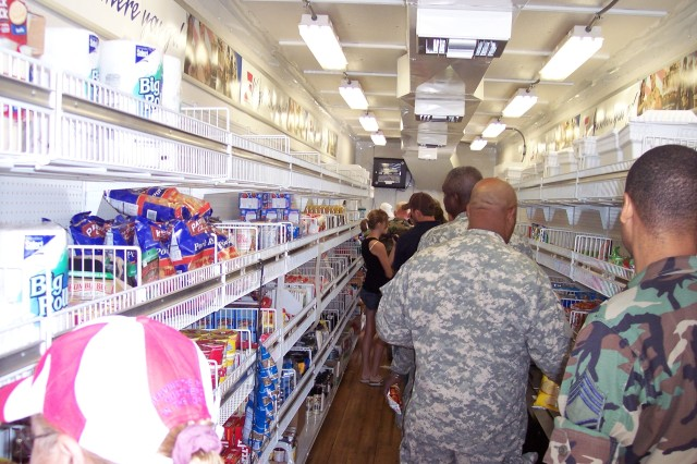 Shoppers wait to check out at the register Sept. 15 in the AAFES Mobile Field Exchange at Ellington Field, Texas, set up for troops providing relief to Hurricane Ike victims.