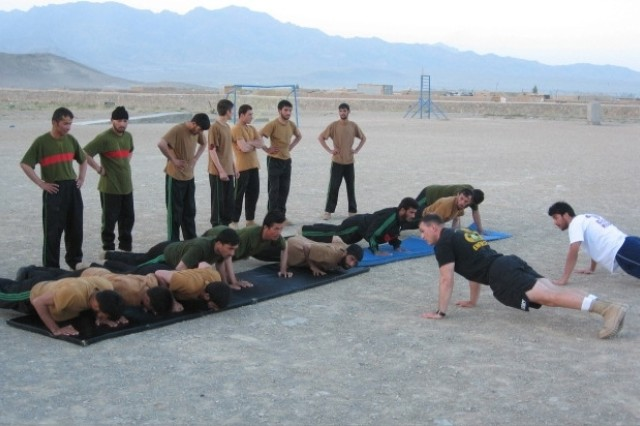 Sgt. 1st Class Steve Palazzo, a native of Charlotte, N.C., leads Afghan National Army Military Police Class 01-08 in an early morning physical training session.