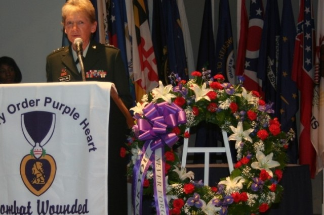 Major General Deborah C. Wheeling, Deputy Surgeon General for the Army National Guard. addresses the audience at the Military Order of Purple Heart's Ceremony memorial service honoring Nurses.  This year's ceremony paid a special tribute Captain Maria Ortiz, who was killed in Iraq. The wreath laying was at the foot of the Nurses Memorial at Arlington Cemetery, Section 21, honoring the service of the many nurses who served and who lay in permanent rest in their special section of Arlington Cemetery.