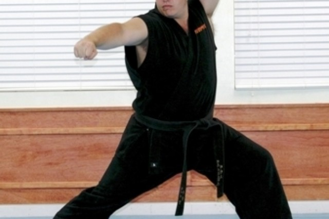 Army Civilian Hank Minitrez hopes to earn enough votes to be named Black Belt Magazine's Instructor of the Year.