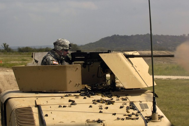 St. Clair Shores Mich. native, Spc. David William Bocquet, a gunner with Trp D, DSTB, 1st Cav. Div., releases a .50 caliber round towards his simulated target during light gunnery training Sept. 11 at Fort Hood, Texas.