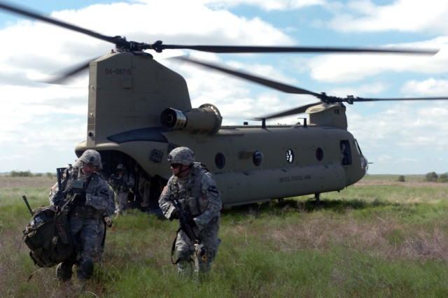 "Soldiers with Company D, 2nd Battalion, 5th Cavalry Regiment, 1st Brigade Combat Team, 1st Cavalry Division, disembarked from a Chinook during an air assault mission conducted during the Rampage field training.  The Soldiers moved from the helicopter to a tactical position outside of an ""Iraqi"" city and offered support by fire to the team inside the city that was capturing and detaining high value insurgents. Rampage is the Ironhorse Brigade's field training exercise to ready Soldiers for deployment."