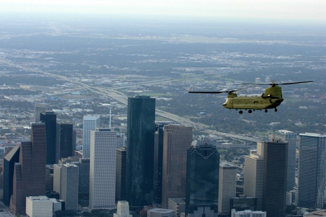 A CH-47 Chinook helicopter from 2nd Battalion, 227th Aviation Regiment, 1st Air Cavalry Brigade, 1st Cavalry Division, flies over Houston on its way to Ellington Field, Texas, for a re-supply mission in support of the Hurricane Ike relief efforts, Sept. 16.