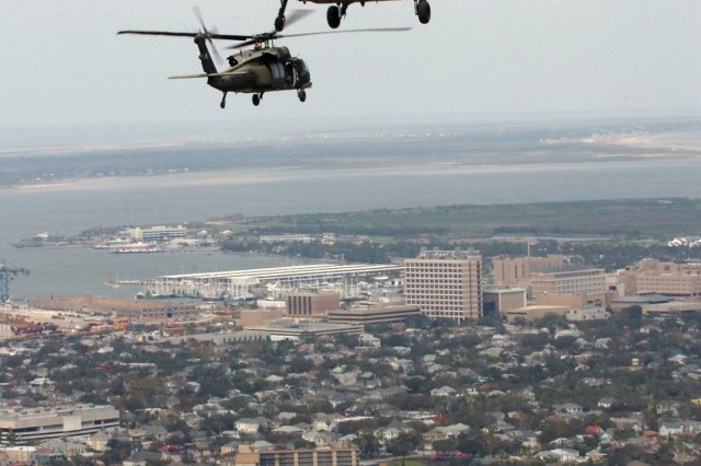 Two UH-60 Black Hawk helicopters from 2nd Battalion, 227th Aviation Regiment, 1st Air Cavalry Brigade, 1st Cavalry Division, fly Gen. Victor Renuart Jr., the commanding general of U.S. Northern Command, and his staff over Galveston, Texas and the surrounding areas during an aerial assessment of the damage left in the wake of Hurricane Ike, Sept. 15.