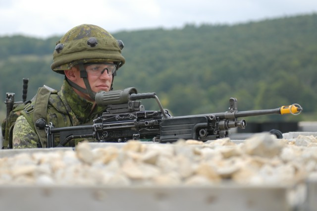 HOHENFELS, Germany, Sept. 17, 2008 - Canadian Army Private Stephen S. Wood from I Company, 2nd Battalion, Royal Canadian Regiment, stands guard outside the shoot house compound of the Joint Multinational Readiness Center near Hohenfels, Germany Wednesday while his platoon completes clearing procedures during practice for a live fire event at Cooperative Spirit 2008. Cooperative Spirit 2008 is a multinational Combat Training Center rotation intended to test interoperability among the American, British, Canadian, Australian and New Zealand armies (ABCA).
