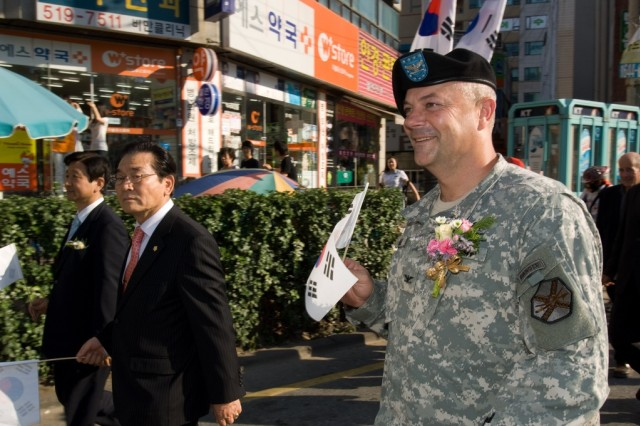 U.S. Army Garrison-Yongsan Commander Col. Dave Hall marches with Korean officials in a parade following a memorial ceremony Sept. 18 to commemorate the 58th anniversary of the victory of the Incheon Landing and to honor the sacrifices of Korean War heroes.