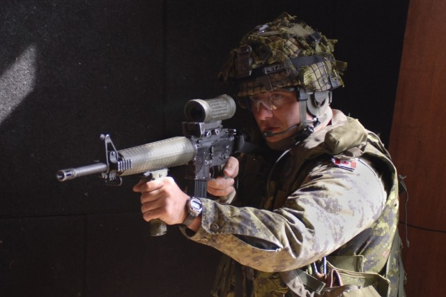 Canadian Army Sgt Rob McGregor, 1st Section Commander, 5th Platoon, 2nd Battalion Royal Canadian Regiment, trains his C-782 rifle on a corner of the shoot house to provide cover fire as needed for his team during the live-fire rotation of their Military Operations on Urban Terrain training at the Joint Multinational Readiness Center shoothouse Sept. 18, as part of Cooperative Spirit 2008.  The American, British, Canadian, Australian and New Zealand Armies' Program is conducting the Cooperative Spirit training event to test and close the gaps in interoperability between the nations.  The 2nd Bn. RCR training was overseen by U.S. Army observer controllers who provided instruction not normally available to Canadian Armed Forces.