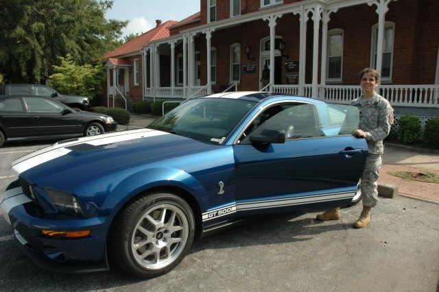 New Fort McPherson JAG, Lt. Col. Meg Foreman, alongside her prized 2007 Ford Mustang Shelby. War Eagle!