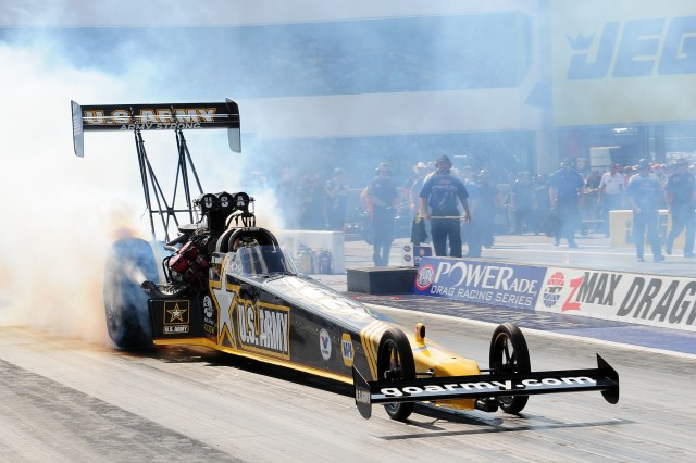 """Army Top Fuel pilot Tony """"The Sarge"""" Schumacher does a burn-out prior to making his run down the 1,000 foot track at the zMax Dragway in Concord, N.C."""