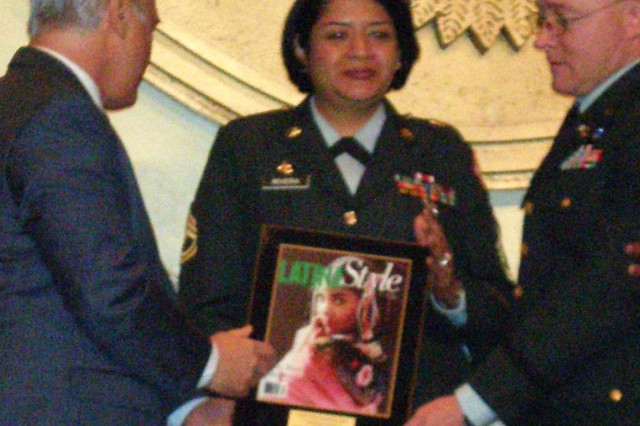 Sgt. 1st Class Dolores Rivera receives the 2008 Latina Distinguished Service award during the National Latina Symposium Sept. 5, from (left) Robert Bard, president and CEO of Latina Style Magazine and Clarence Johnson, principal director, DOD Office of Diversity Management and Equal Opportunity.