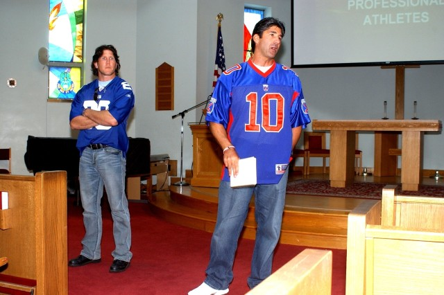 Keith Elias, left, and Anthony Telford, both former professional athletes, spoke to 2nd Brigade Combat Team leaders Monday, during a chaplain's leadership luncheon.