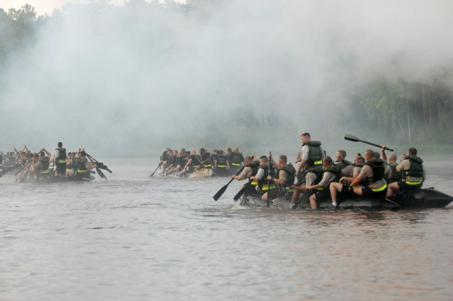 The engineers from the 82nd Airborne Division all paddle across McKellars Lake during the Crossing the Waal River re-enactment race on Sept. 18. All four engineer companies from the four combat brigades participated in the event.