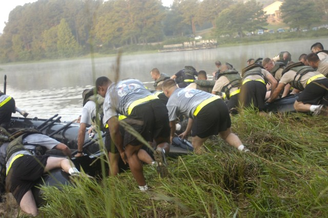 The 1st and 2nd Brigade Combat Team engineers push their boats into McKellars Lake at the start of the Crossing of the Waal River re-enactment competition on Sept. 18. All four engineer companies from the 82nd Airborne Division competed in the event.