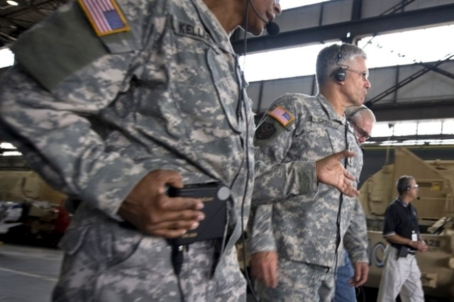 The Anniston Army Depot commander Col. S.B. Keller briefs the Chief of Staff of the Army, Gen. George W. Casey Jr.  about the monthly output of tanks that are sent back to Soldiers Sept. 18, 2008.