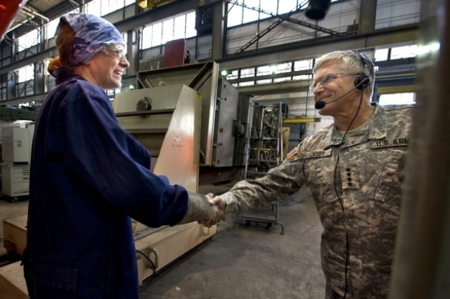 Sommer Johnson, an Anniston Army Depot mechanic, shakes hands with Gen.. George W. Casey, Jr., Chief of Staff of the Army, in Anniston, Ala., Sept. 18, 2008.