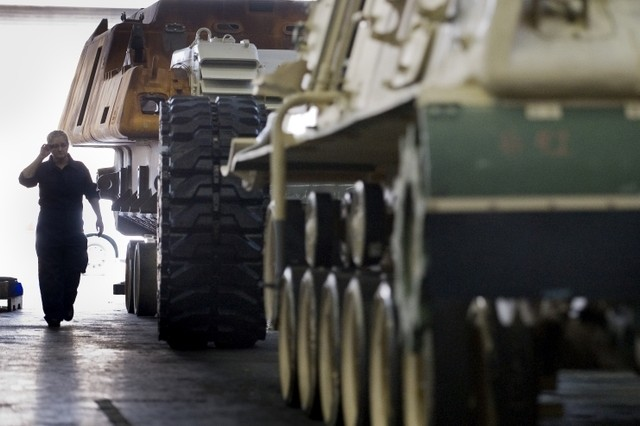 An Anniston Army Depot mechanic approaches an Army vehicle that has had the tracks removed and is being reset for service in Anniston, Ala., on Sept. 18, 2008.