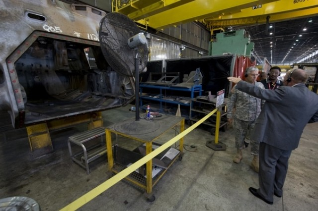 Chief of Staff of the Army, Gen. George W. Casey Jr. is shown the hull of an armor vehicle that is being reset for service at the Anniston Army Depot in Anniston, Ala., on Sept. 18, 2008. The depot is the designated Center of Industrial and Technical Excellence for tracked wheeled combat vehicles, artillery, bridging systems and small caliber weapons.