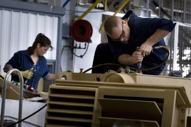 Mechanics make repairs to Army vehicles at the Anniston Army Depot in Anniston, Ala., on Sept. 18, 2008. The depot is the designated Center of Industrial and Technical Excellence for tracked wheeled combat vehicles, artillery, bridging systems and small caliber weapons.