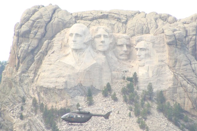 Past presidents are treated to an aeronautical spectacle as a Lakota helicopter flies by Mount Rushmore in South Dakota. The bird was en route to the 132nd Rosebud Reservation powwow Sept. 22. Soldiers with Alpha Company, 5th Aviation Battalion, met with members of the Lakota Tribe to show the Army's newest aircraft to the people of its namesake. Both parties gained a new understanding about each other and created a lasting bond.