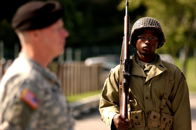 1st Lt. Damien Zeigler, assigned to the 81st Regional Readiness Command, stands at attention as Maj. Gen. Charles Gorton executes orders during a casing ceremony held on Sept. 21, 2008, in Birmingham, Ala. The 81st RRC will move to Fort Jackson, S.C., and be re-established as the 81st Regional Support Command.