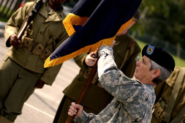 """Command Sgt. Maj. Roxanne Castille, 81st Regional Readiness Command, prepares to pass the """"Wildcat"""" colors to Maj. Gen. Charles Gorton during a casing ceremony held Sept. 21 in Birmingham, Ala. The 81st RRC will move to Fort Jackson, S.C., and be re-established as the 81st Regional Support Command."""