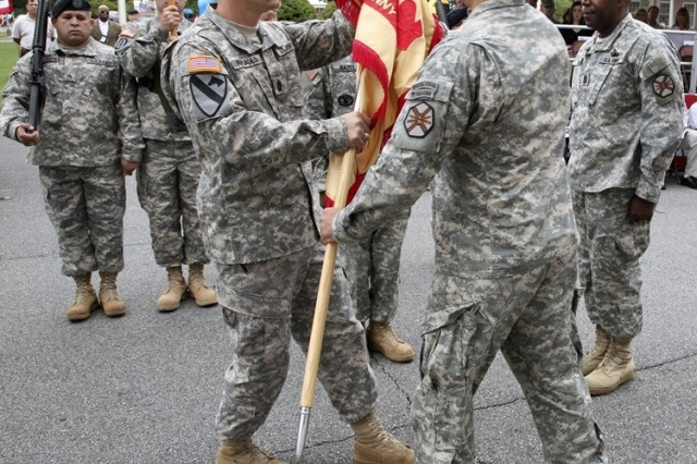 Lt. Col. John P. Stack, Garrison Commander, Picatinny Arsenal, passes the guidon to Command Sgt. Maj. Rodney Rhoades as he assumed the responsibilities as Command Sgt. Maj. during the change of responsibility ceremony at the installation Sept. 12