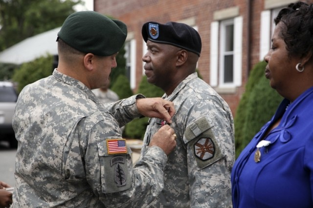 Lt. Col. John P. Stack, Garrison Commander, Picatinny Arsenal, pins the Legion of Merit on the uniform of Command Sgt. Maj. John Graves during his retirement and change of responsibility ceremony at the installation Sept. 12