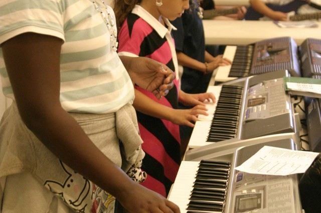 "SCHOFIELD BARRACKS, Hawaii - From left to right - Latiara Robertson, Tiana Arzuaga and Ekim Gabino tickle the ivories during ""band practice"" at SKIES. Rock School presents students with hands-on learning techniques to maximize their musical potential on their instrument of choice."