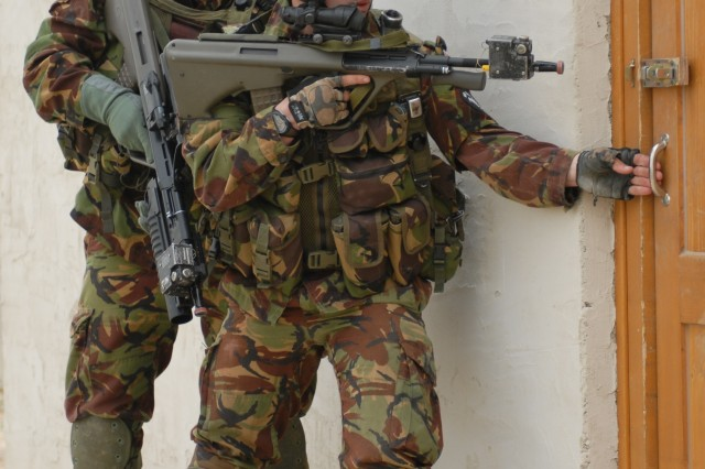 JOINT MULTINATIONAL READINESS CENTER, Germany, Sept. 20, 2008 - New Zealand Army Soldiers from 2nd /1st Battalion, Royal New Zealand Infantry Regiment prepare to enter and assault a building while participating in a cordon and search training mission Saturday, during Cooperative Spirit 2008 at the Joint Multinational Readiness Center near Hohenfels, Germany.  Cooperative Spirit 2008 is a multinational combat training center rotation intended to test interoperability among the American, British, Canadian, Australian and New Zealand Armies.