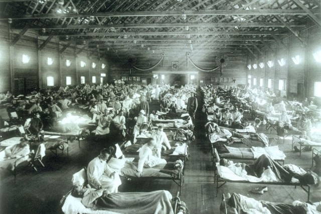 Historical photo of the 1918 Spanish influenza ward at Camp Funston, Kan., showing the many patients ill with the flu, should remind all of the importance of getting flu shots.