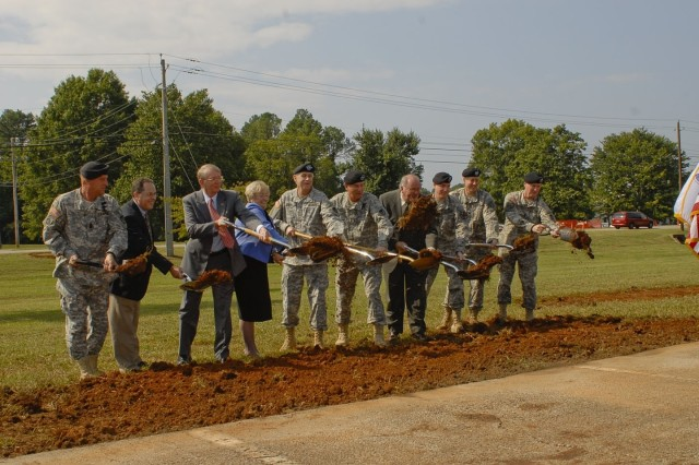 The official party breaks ground.  From left to right - Aviation and Missile Life Cycle Management Command Sgt. Maj. Ricky P. Yates; Jackie Stevenson, B.L. Harbert; Mayor Sandy Kirkendall, Madison; Mayor Loretta Spencer, Huntsville; Gen. Benjamin S. Griffin, U.S. Army Materiel Command commanding general; Maj. Gen. James Myles, AMCOM LCMC commander; Richard Alpaugh, U.S. Army Security Assistance Command deputy commander; Col. Robert Pastorelli, garrison commander;Col. Byron Jorns, U.S. Army Corps of Engineers Mobile District commander; and Army AMC Command Sgt. Maj. Jeffery Mellinger.