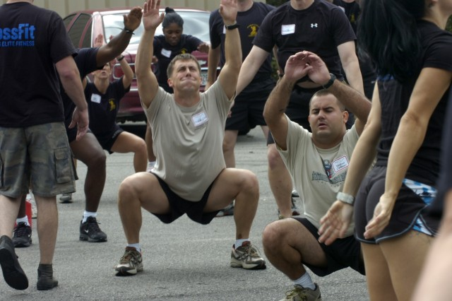 Several Paratroopers from the 407th Brigade Support Battalion, 2nd Brigade Combat Team, and the 1st Battalion, 508th Parachute Infantry Regiment, 4th Brigade Combat Team, 82nd Airborne Division show the agony on their face while doing squats during a two day CrossFit certification in Southern Pines on September 17 and 18. The paratroopers had to do 20 seconds of squats with 10 seconds of rest for eight repetitions.  (U.S. Army photo by Sgt. Susan Wilt, 2nd BCT, 82nd Abn. Div. PAO)