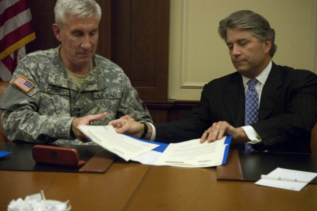 Maj. Gen. Peter S. Cooke, Commanding General 96th Regional Readiness Command, and Calvin Frese, President, Americas, CB Richard Ellis, Inc., sign a Memorandum of Agreement for the U.S. Army Reserve Employer Partnership Initiative during a signing ceremony at the Union League Club of Chicago, Tuesday, September 23, 2008.