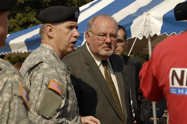 Gen. Benjamin S. Griffin, AMC commander, and Richard Alpaugh, USASAC deputy commander speak to reporters after the groundbreaking Sept. 17.
