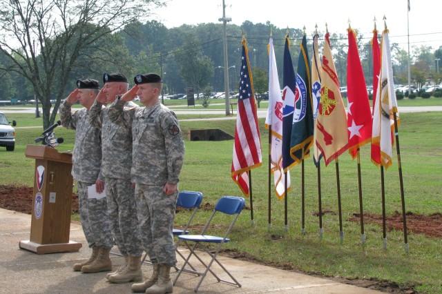 Rendering honors at the start of the groundbreaking ceremony are, from left, AMC commander Gen. Benjamin Griffin, AMCOM commander Maj. Gen. Jim Myles and Garrison commander Col. Bob Pastorelli.