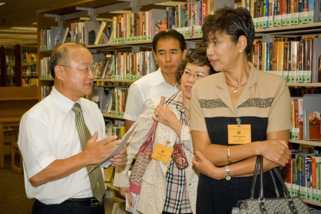 (Right to left) Korean university librarians Kim Young-aie, Cho Hyun-kil and Jeong Kyu-jeong listen to Yongsan librarian Choi Sung-han during a Good Neighbor Program tour of the library.