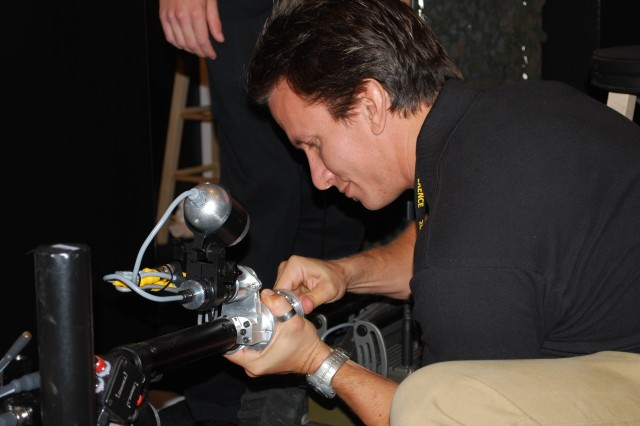 Lonnie Freiburger, Tank-Automotive Research, Development and Engineering Command engineer, performs maintenance on the iRobot® Packbot at the 2008 Infantry Warfighter Conference in Columbus, Ga.