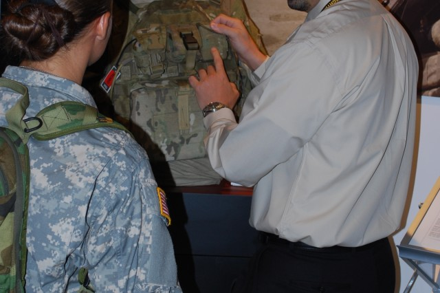 Dutch DeGay, U.S. Army Natick Soldier Research, Development and Engineering Center, explains the Future Warrior Technology Integration efforts of NSRDEC to Soldiers attending the 2008 Infantry Warfighter Conference in Columbus, Ga.